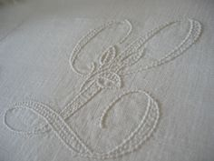 L is for Linen - exquisite antique French linen bed cover bought at a local brocante. Photo by Shu