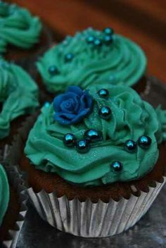 Sea green and Royal blue frosted cupcake! Could do roses on top instead, with white edible pearls and green on bottom