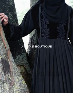 Lady Velvet Empress Abaya The Beautiful design and exquisite flawless Lady Velvet Empress Abaya is made of rich High quality Nida Fabric and smooth delicate velvet. The abaya a rich black smooth velvet clad bodice with intricate black embroidery of foilag Abaya Fashion, Muslim Fashion, Abaya Designs Latest, White Embroidered Dress, Islamic Clothing, Silk Slip, Muslim Women, Modest Outfits, Designer Dresses