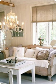 Shabby chic living room - love the beadboard, and the chandelier