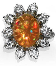 *A fire opal and diamond ring oval-shaped fire opal cabochon measuring… #opalsaustralia