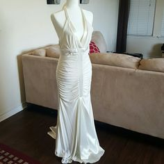 Jessica McClintock long dress Beautiful Off White long dress with mini flow in back. Has satin throughout the dress and in front and back bottom. Never worn. Great for Prom or wedding Jessica McClintock Dresses Prom