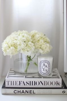 decor details - diptyque candle, books and flower