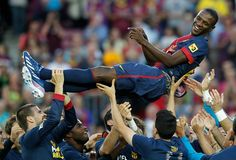 Barcelonas Eric Abidal is tossed by teammates after his last match with Barcelona after their Spanish first division soccer league match against Malaga at Camp Nou stadium in Barcelona June 1, 2013. Popular former France defender Abidal is to leave Barcelona when his contract expires at the end of the season. REUTERS/Albert Gea
