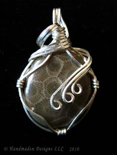 This is a sterling silver wire-wrapped Petoskey Stone pendant.  The Petoskey Stone is one that I dug up myself at Lake Michigan and has been entirely hand-polished.  The pendant measures at about 1 inch long. Handmaden Designs LLC