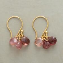 This pair of pink rain tourmaline earrings endears with its bashful hues.