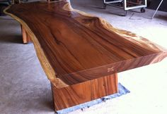 Description:  All of our tables are customized and made to order and it will be our pleasure to tailor make a solid acacia wood large slab table for you similar to this piece. This table was a customized piece we created for a client in Abu Dhabi. This very unique table was constructed from a Single Slab of Thai Acacia which is an extremely rare wood and size. It takes a many years for this type of wood tree to grow to these sizes. It is a extra hard wood and has beautiful deep grain.  The…