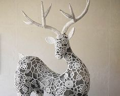 """Incredible crocheted reindeer from Aussie designer Angela van Boxel. Made from wire and fused plastic bags, """"Blitzen"""" is covered in an ornate crochet pattern, also made from white plastic bags used as yarn. A truly innovative piece of art"""