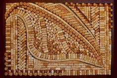 """A friend of mine has a """"Cork"""" board like this, and it's really cute. I like the idea of making a pattern with the corks. We'd never drink enough wine to make this, but maybe one of the many wine restaurants in Uptown will be willing to give me theirs... (Note: You CAN actually pin things to this when it's done, just like a standard cork board).:"""