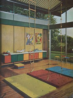 Play room (Love the colored cabinets along the wall!)