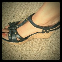 """Pair of 8"""" Madden Girl black wedge sandals. Black leather with golish/bronze accents on cork-like platform wedge. No signs of wear other than the soles. Madden Girl Shoes Wedges"""