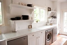 Our bright, white, open kitchen - modern - laundry room - dallas - Emily McCall