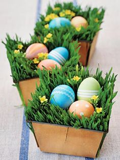 Centrepiece - small wooden boxes with green grass, flowers and easter eggs