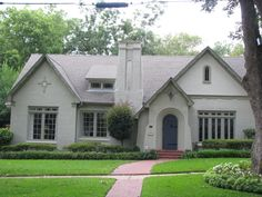 Tunnell-Robinson House (1930): painted brick house with Gothic and Tudor elements - Tyler, TX