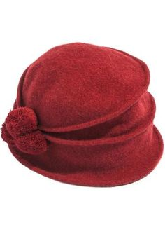 Wool Knit Hat in color Rubi with 3 matching pompoms on back. Keep your head warm and be stylish at the same time. 100% Wool, hat is one size fits all.