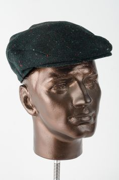This beautifully textured staple flat cap is produced from a dark green  speckled wool. May f717f13b532
