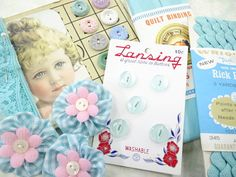 Craft kit of fun vintage items, like trims, buttons, yo-yos, rick rack and more in light blue tones