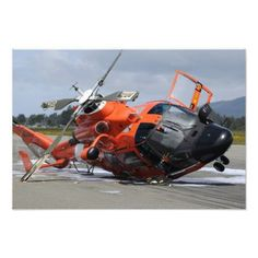 A US Coast Guard Dolphin helicopter lays on its side after it crashed at the Arcata Airport during a training mission Canvas Art - Stocktrek Coast Guard Helicopter, Us Coast Guard, Military Helicopter, Military Aircraft, Bell Helicopter, Sikorsky Aircraft, Aviation Humor, Aviation Technology, Aviation Art