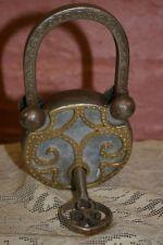 Ornate vintage padlock and key.