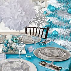 A wintery Christmas party tablescape! Created with Party City plates, chargers, votives, glassware and hanging decor. Even coordinates with the tree. <3!