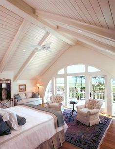 <3 this bedroom, vaulted ceiling and a half circular window which leads out to a private balcony.