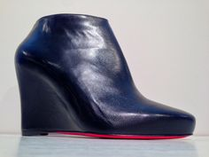 Cat Woman 2013! Christian Louboutin platform ankle boot in leather with inside zip and buckle with loop on the outside.