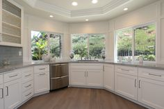 Wainscoting on walls around windows in kitchen. Sea Pearl Quartzite, Local Real Estate, Wainscoting, Kitchen Cabinets, Walls, Windows, Home Decor, Restaining Kitchen Cabinets, Homemade Home Decor