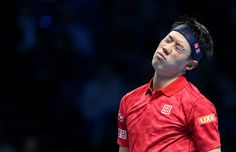 Kei Nishikori of Japan in action against Marin Cilic of Croatia in their Group John McEnroe match on day six of the ATP World Tour Finals at O2 Arena...