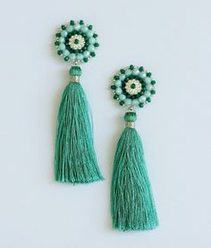 Add a little pop of color to your summer outfit with these colorful, handmade tassel earrings crafted by Juniiq Jewelry with sterling silver posts. Shop them now at Parlor & Pantry. #jewelry #turquoise #handmade