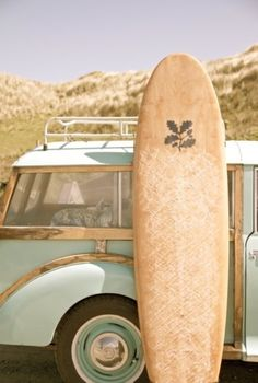 retro surfboard and we have to talk about that car. love