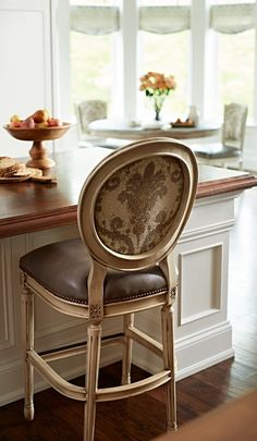 Our finely crafted Langston Bar Stool brings a classic Louis XVI medallion chair to new heights. Elegant and easy, Langston features fluted legs and a cushioned seat and back, richly upholstered in coal-black top-grain leather.
