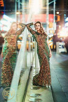 Senior picture portrait ideas New York City NYC christmas time times square fashion editorial sequins lights formal prom reflection