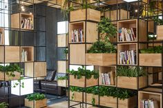 Known as the Home Café, this café design in Beijing incorporates immense amounts of recycled steel bars that are intricately crafted into a grid system. Shelving Design, Modular Shelving, Bookshelf Design, Bookshelf Ideas, Cafe Interior, Interior Design, Deco Cafe, Cafe Pictures, Creative Bookshelves