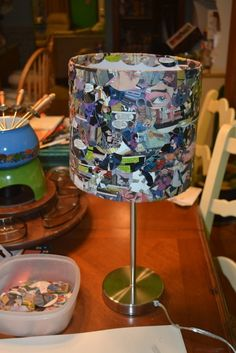 Comic book lamp.Ive done this before and I forgot about it! All you need are some comic books and mod podge.Unlike this one, I hot glued ribbon to the top and bottom. Also I ModPodged the base with comic books.Let dry, turn on.Get your lamp from a thrift store or ikea*ikea has awesome mini lamps, great for gifts*
