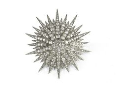 An antique diamond starburst brooch, set with 11.50ct of old-cut diamonds, mounted in silver-upon-gold,circa 1890.