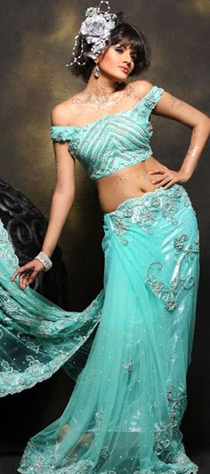 Aqua shade Saree is decorated with sequins buttis and floral appliques embellished with sequins and kundan.