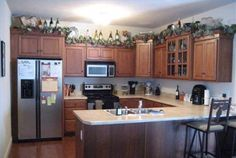 Decorating Above Kitchen Cabinets With Flowers