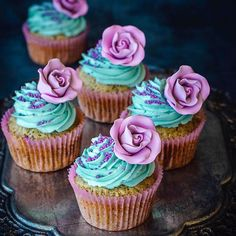 No Rosewater today, but I've got roses for you! Remember the purple gum paste flowers I was talking to you about a few posts back? I've been waiting to show them off and these Earl Grey cupcakes were made just for that. And the teal on the frosting i...
