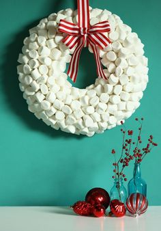 Make this Marshmallow DIY Winter Wreath. All you need is a bag of marshmallows, a foam wreath form, glue, toothpicks, and a pretty peppermint striped ribbon to complete this DIY winter wreath. Homemade Christmas Wreaths, Holiday Wreaths, Christmas Crafts, Christmas Decorations, Holiday Decor, Christmas Holiday, How To Make Marshmallows, 242, Wedding Crafts