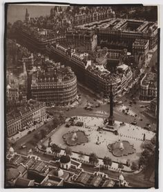 A bromide print photograph entitled 'Trafalgar Square', taken by an unknown photographer, c. 1920. This aerial photograph shows the roof of the National Gallery and the streets leading away from Trafalgar Square, London.