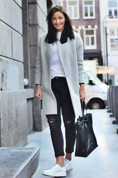 Shop this look on Lookastic: http://lookastic.com/women/looks/derby-shoes-tote-bag-skinny-jeans-coat-crew-neck-t-shirt/8009 — White Leather Derby Shoes — Black Leather Tote Bag — Black Ripped Skinny Jeans — Grey Coat — White Crew-neck T-shirt