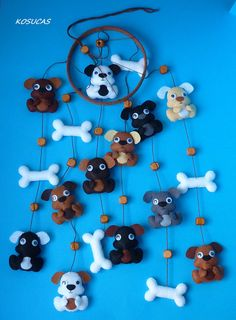 Felt mobile with dogs.