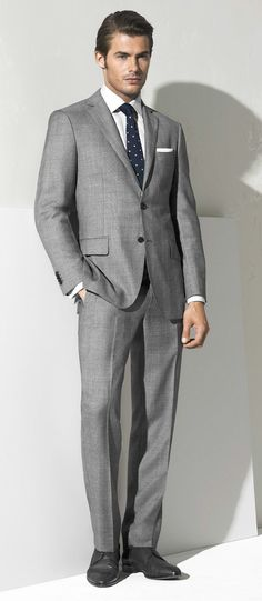 MJ Bale Christian two button wool pow check suit, Travis end-on-end shirt, knit tie and Hugo Boss Sanett shoe.