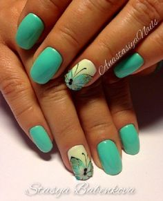 Simple and beautiful turquoise blue themed butterfly nail art. The butterfly wings are cleverly designed to fit the tips of the nails.