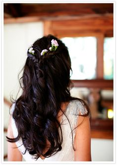 simple curls and braided crown with floral accents