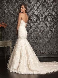 Lace and Organza fit and flare with sweetheart neckline and has gorgeous with beading throughout the dress. Small buttons run all the way down the back of the dress. It has a French bustle as well. It