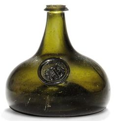 A SEALED ARMORIAL WINE-BOTTLE CIRCA 1700-20