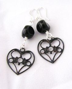 Valentine's don't have to be all reds and pinks.  Here's a pair of heart earrings for the Goth/Steampunk/Horror girl in you!  New in my Etsy shop.