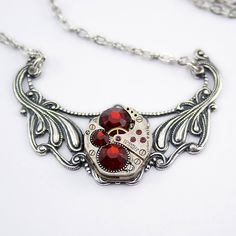 Steampunk Fashion Necklace fashioned with a Gorgeous Vintage Watch Movement Accented with Gorgeous Siam Red Swarovski Crystals