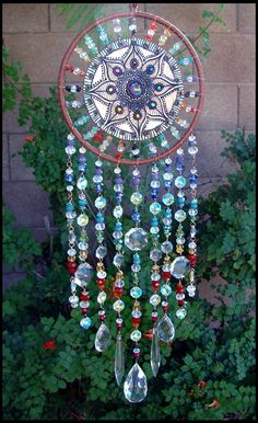 Clay, Crystal, Gemstone, and Leather Dream Catcher made with all of the antique crystals collected over the years.Crystal dream catcher mandala hanging home decor boho bohemianBeautiful And Stunning Dream Catcher Ideas - jihanshanumMandela inside a d Carillons Diy, Diy And Crafts, Arts And Crafts, Diy Wind Chimes, Crystal Wind Chimes, Sun Catcher, Yard Art, Craft Projects, Crafty